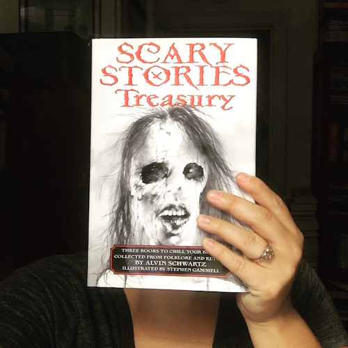 Carmen Machado holding up the book Scary Stories Treasury